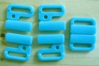 3 Paar Verschlüsse in kräftigem türkis-blau