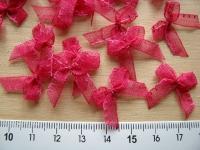 4 Schleifchen in fuchsie/pink